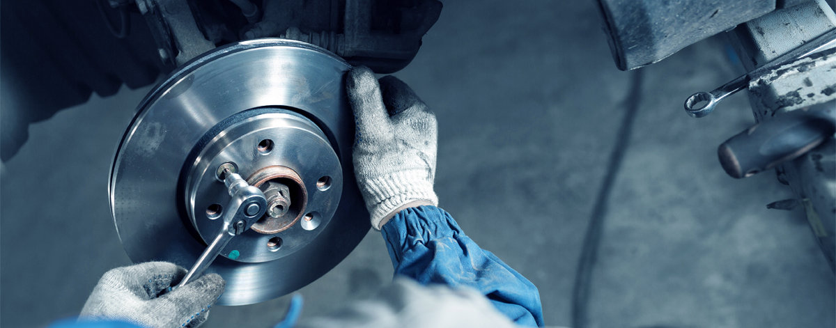 Mechanic fitting a new brake disc - Car Repairs Newcastle Upon Tyne